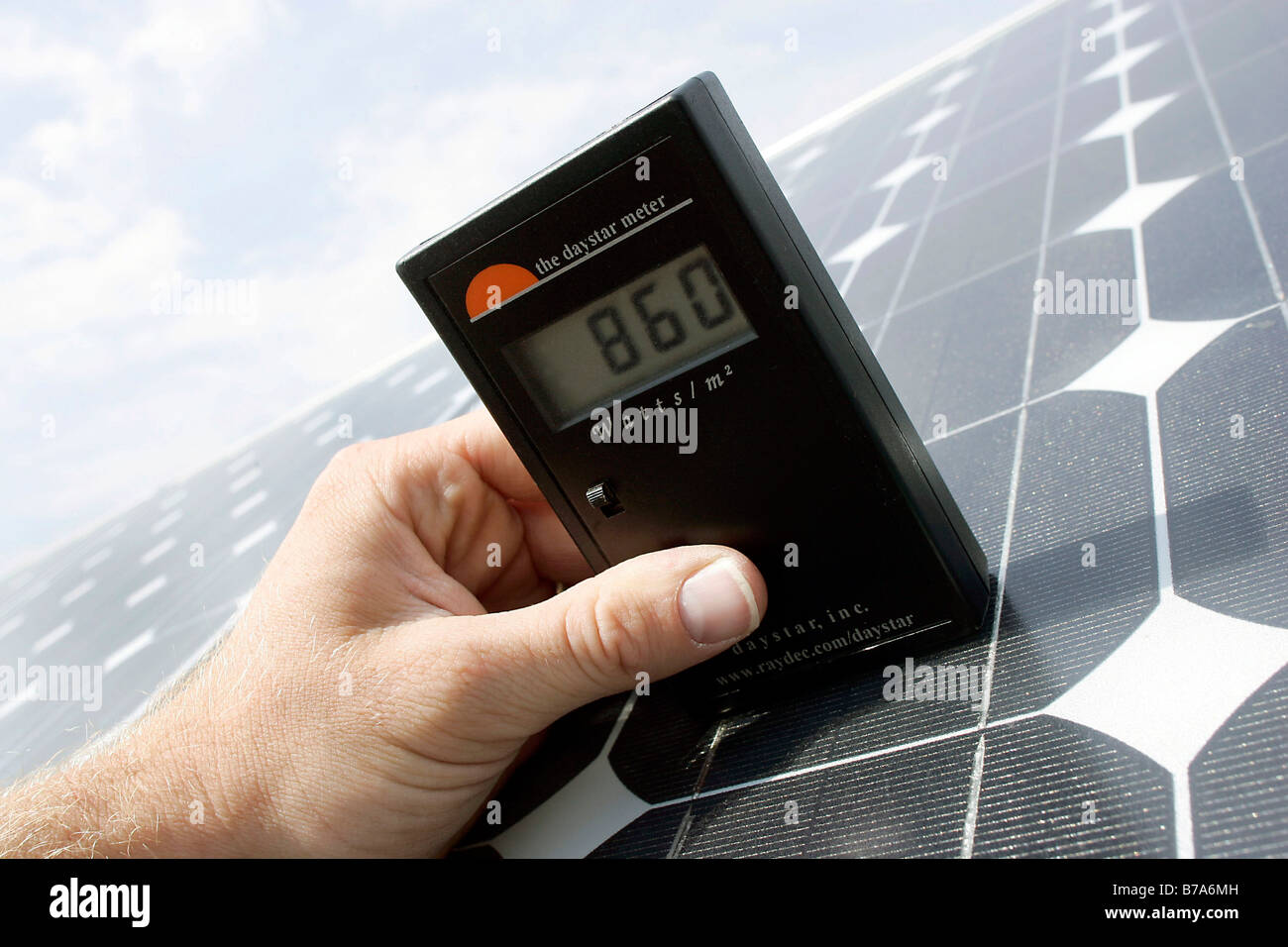 Manual measurement of solar radiation at a photovoltaic module of the Powerlight Company in the Bavarian Solar Park - Stock Image