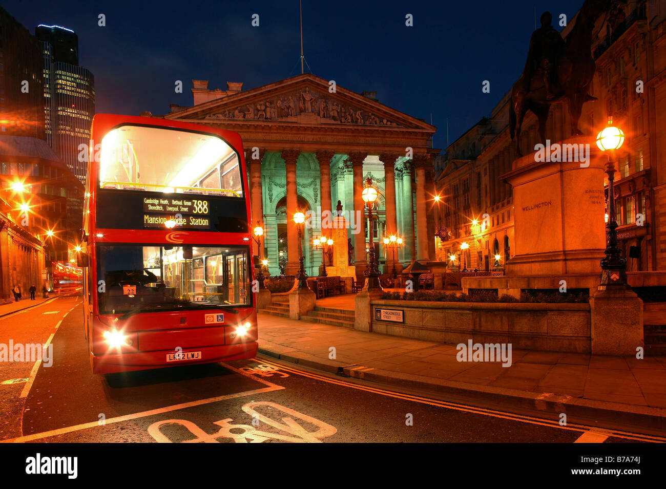 Double-decker, Royal Exchange in the Threadneedle Street at night in London, England, Great Britain, Europe - Stock Image