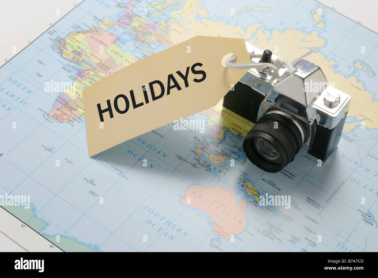 Camera on world map with 'Holidays' tag Stock Photo