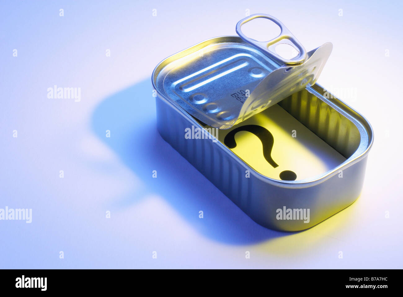 Question mark card in a tin can - Stock Image