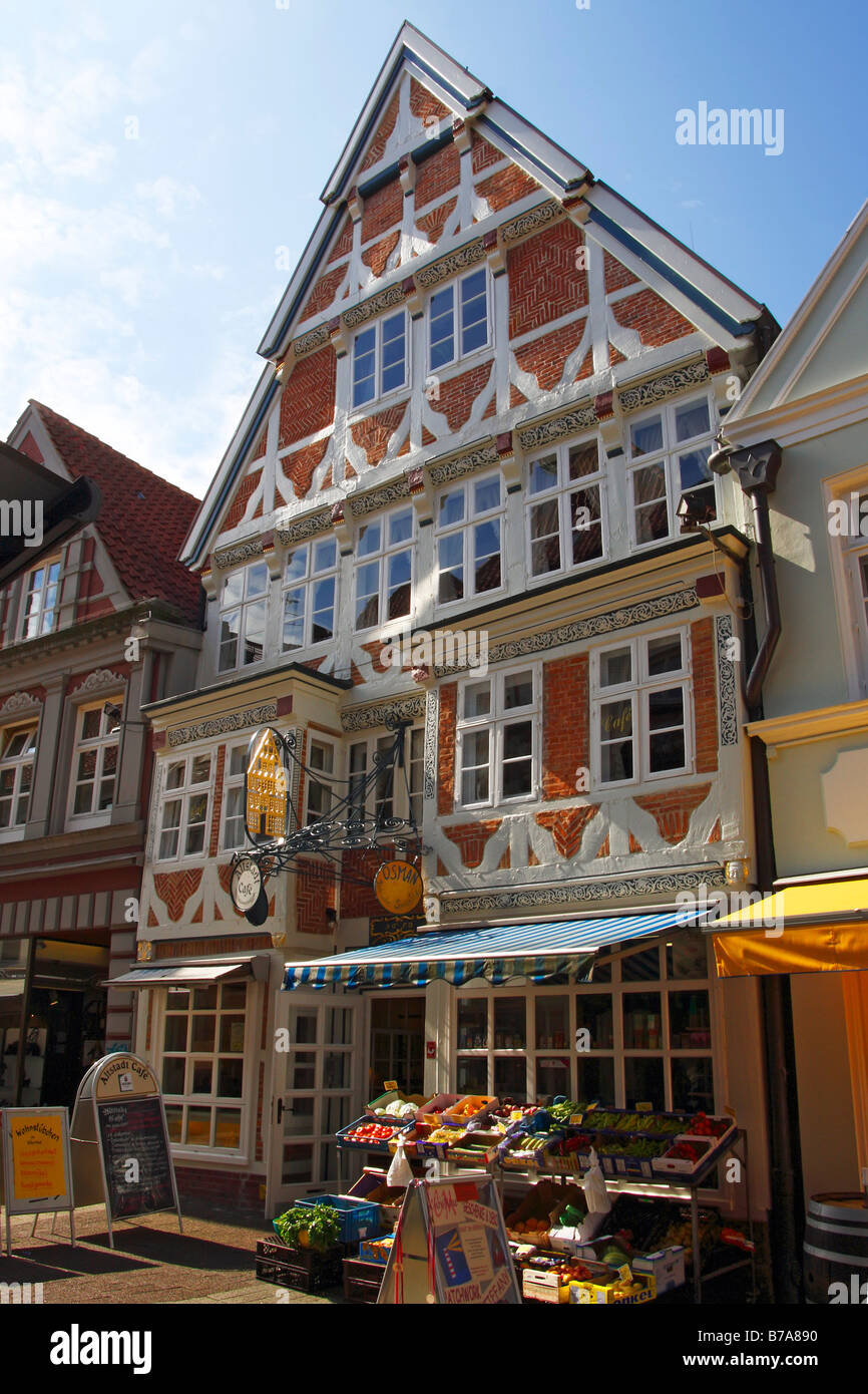 Historic timber-framed house with a cafe and fruit shop in the historic centre of Stade, Altes Land, Lower Saxony, Stock Photo