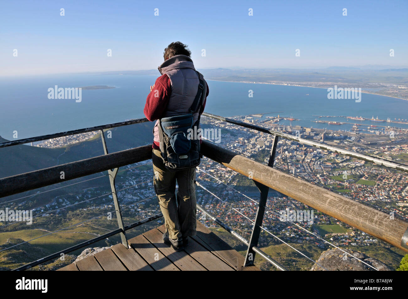 Woman looking onto Cape Town from the top of Table Mountain, South Africa - Stock Image