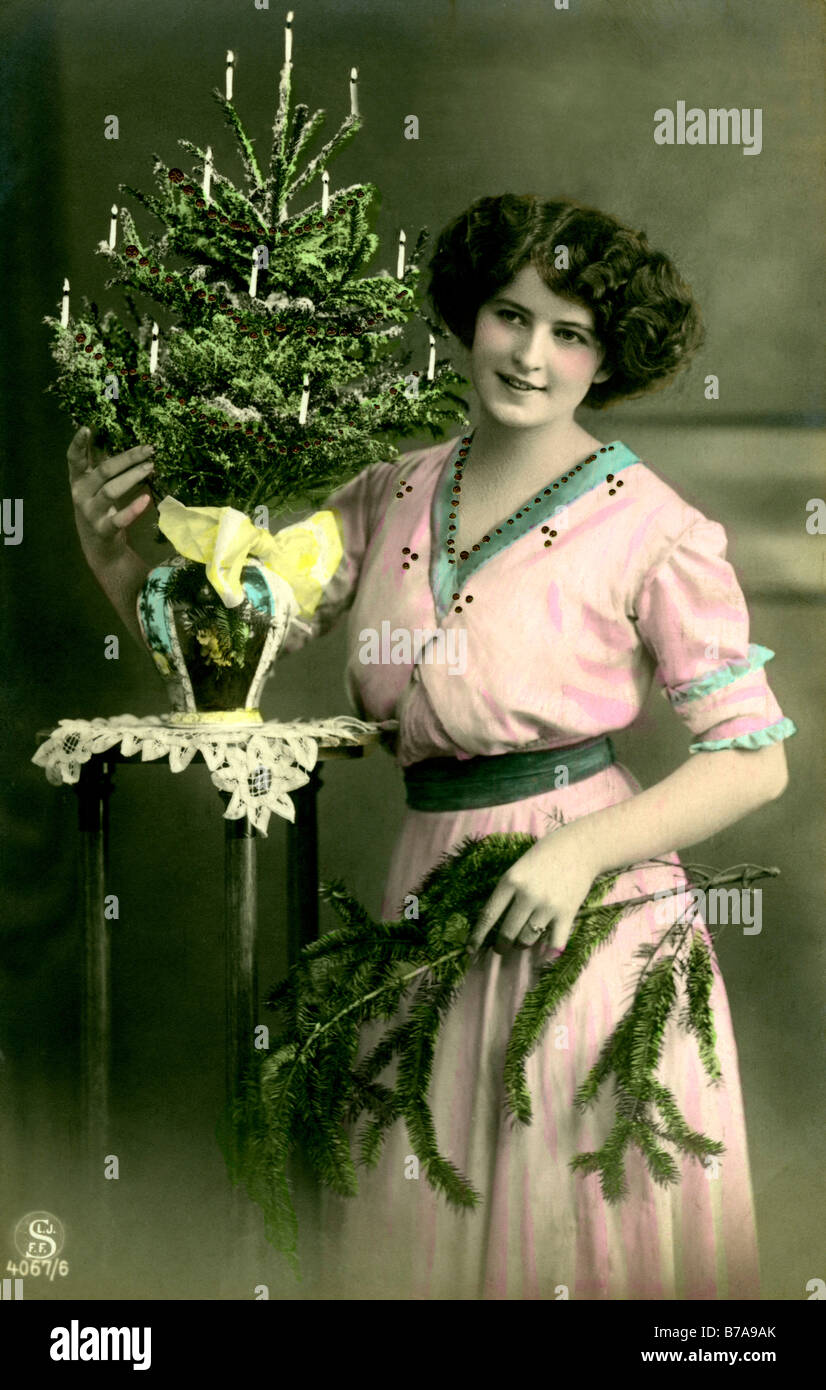 Historical photo, woman with Christmas tree, ca. 1910 - Stock Image