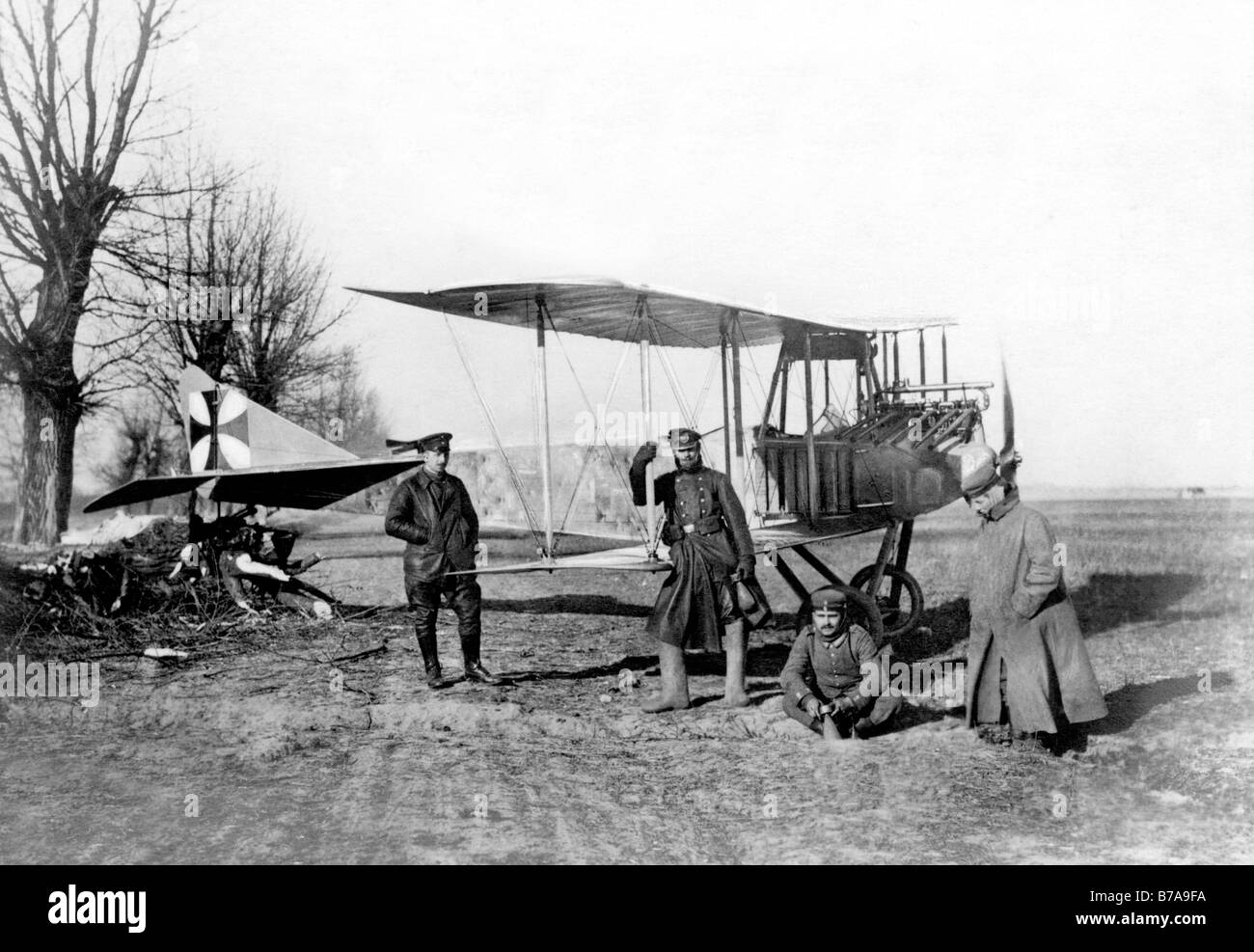 "Historic photo, First World War, air force, ""German airplane anchored on a tree stump in the Polish lowlands. Both Stock Photo"