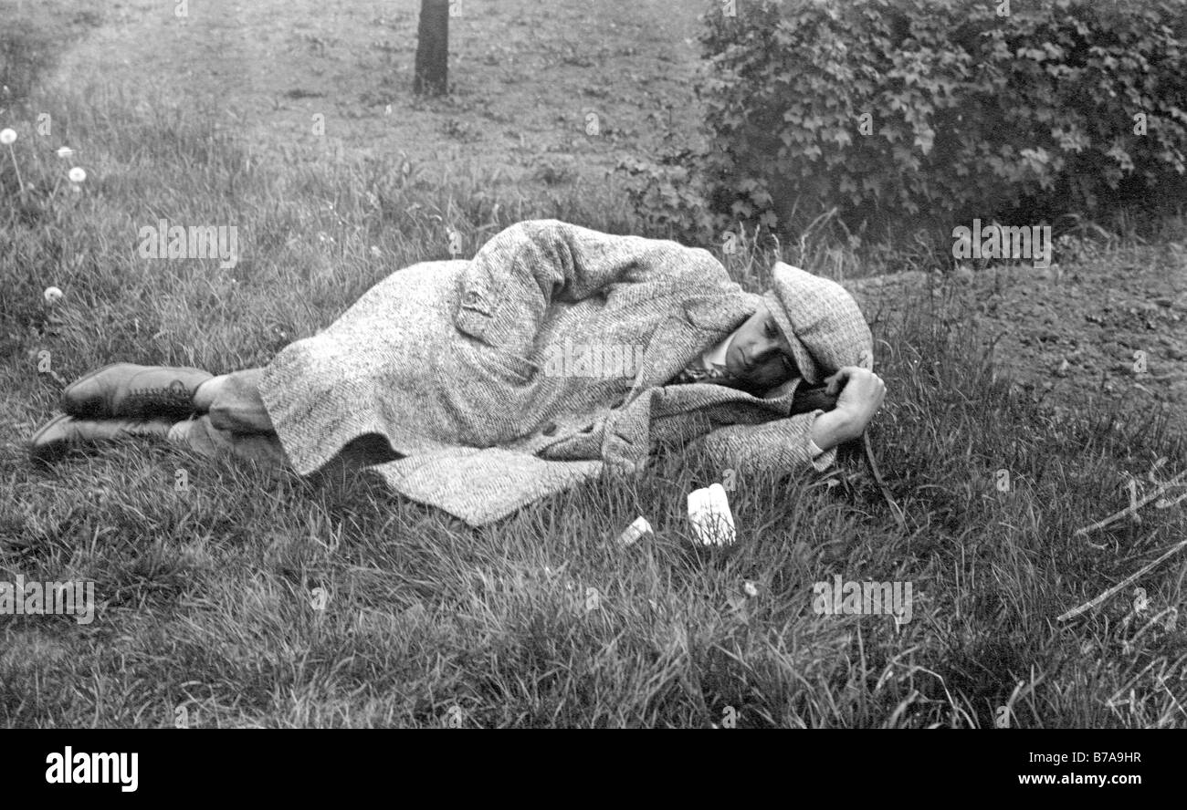 Historic photo, man sleeping in the grass, ca. 1930 - Stock Image