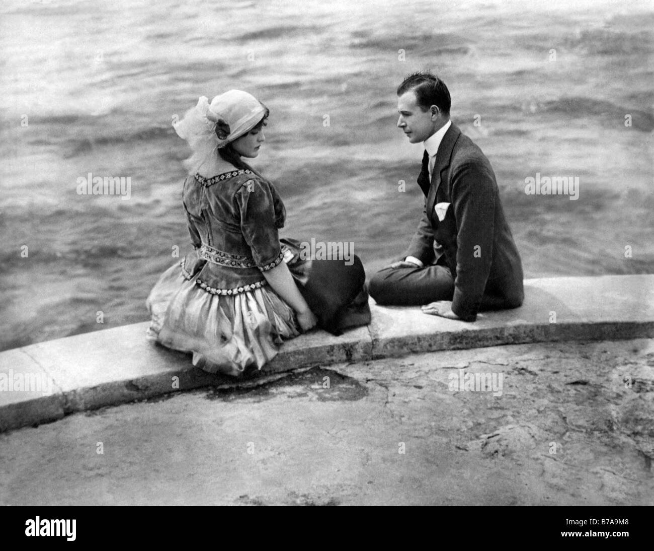 Historic photo, couple discussing by the river, ca. 1930 - Stock Image