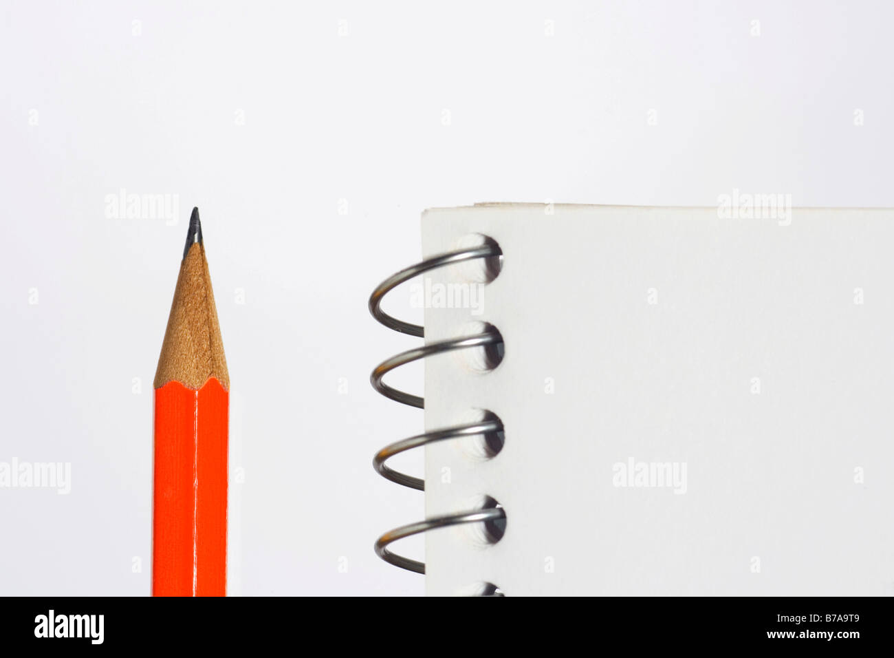 Spiral notebook and pencil, detail Stock Photo