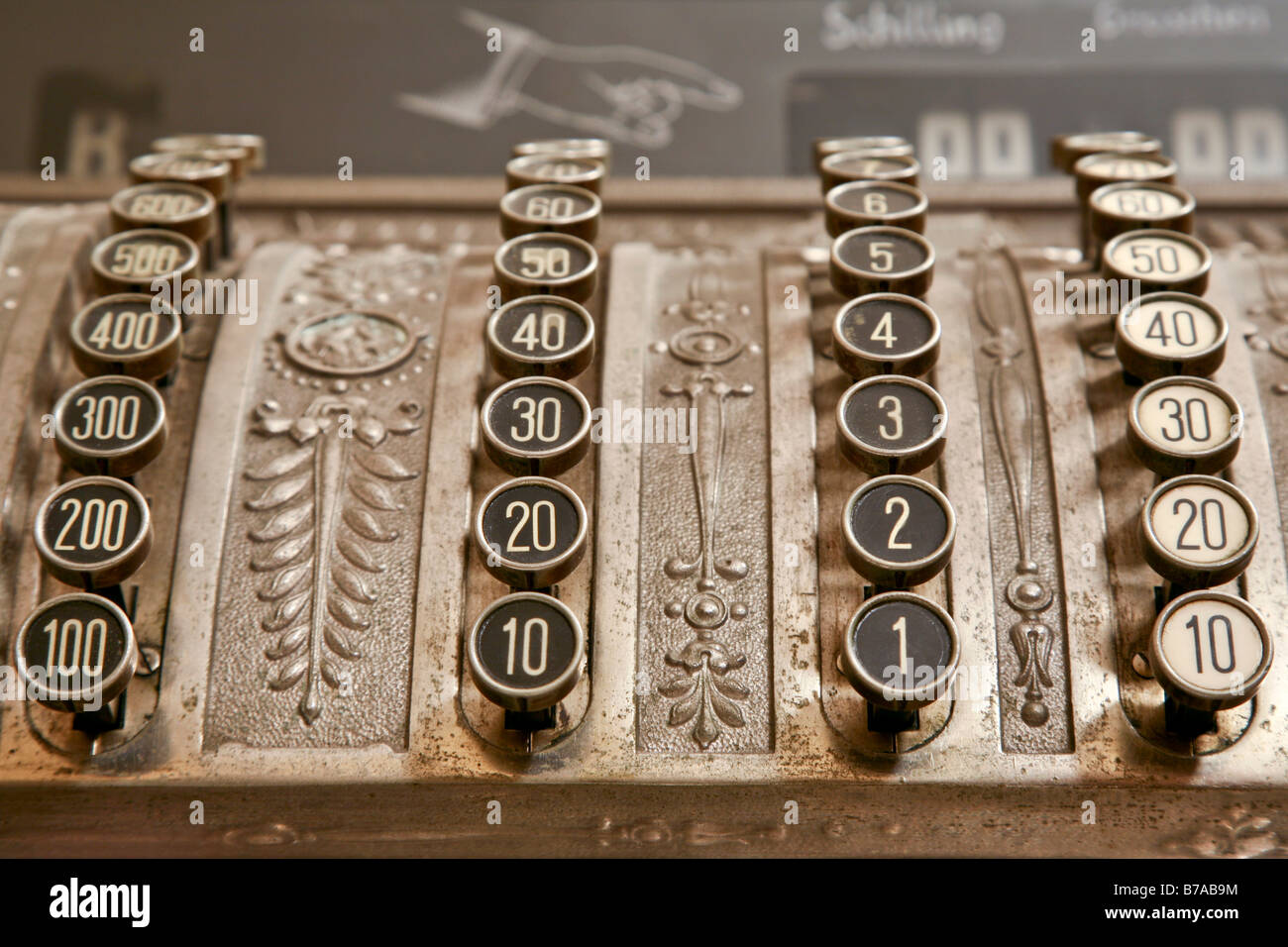 Old cash register with hundreds, tens, ones and tenths keys - Stock Image