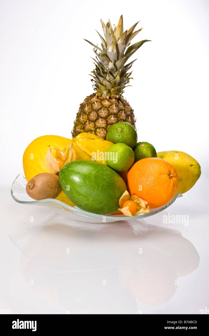 Gemeinsame Exotic fruit in a glass bowl, pineapple, melons, grapes, orange #NR_83