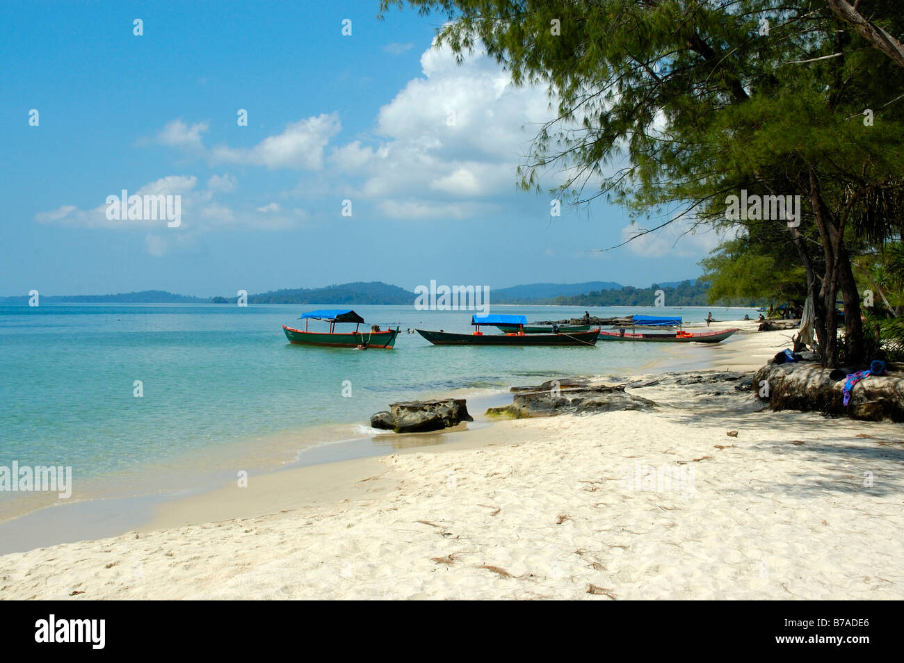Fishing boats, secluded white sandy beach, clear blue water, Ream Nationalpark near Sihanoukville, Kompong Som, Stock Photo