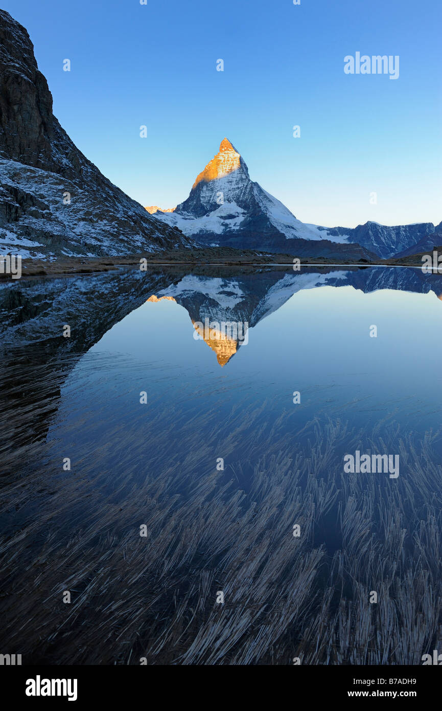 Matterhorn reflecting in Riffelsee, Zermatt, Wallis, Switzerland, Europe - Stock Image