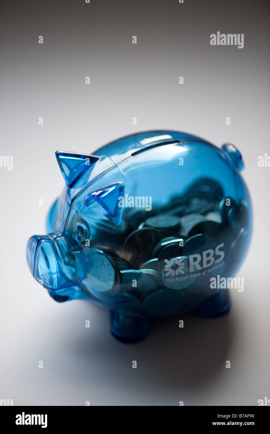 RBS Royal Bank of Scotland piggy bank full of coins saving money savings cash UK sterling currency credit crunch - Stock Image