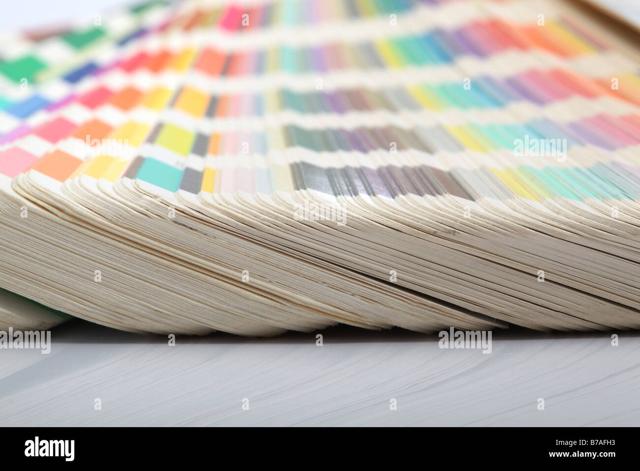 detail from pantone color scale samples with reflection lithography printing industry - Stock Image