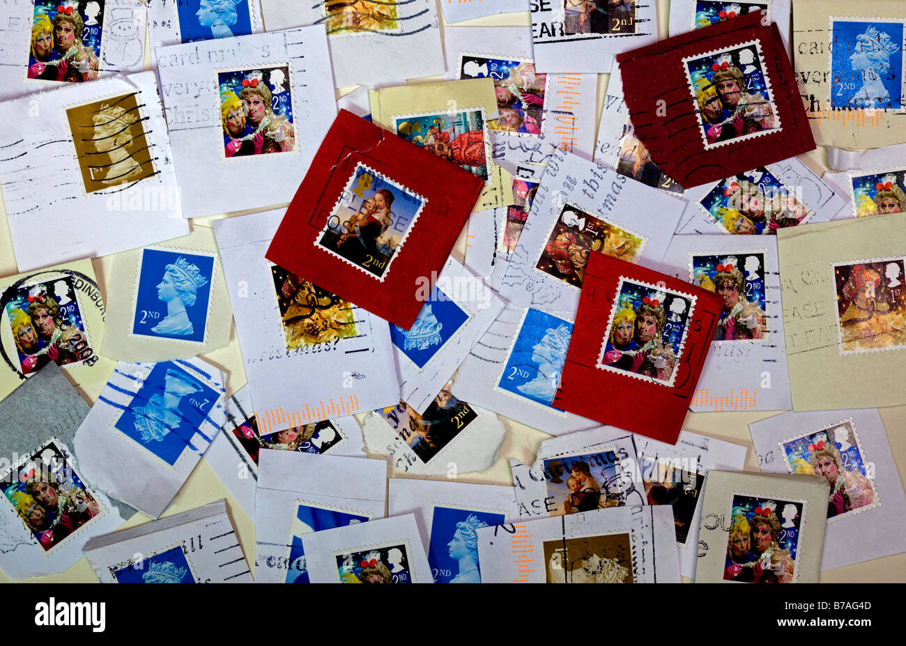 British used postage stamps saved to recycle for charity - Stock Image