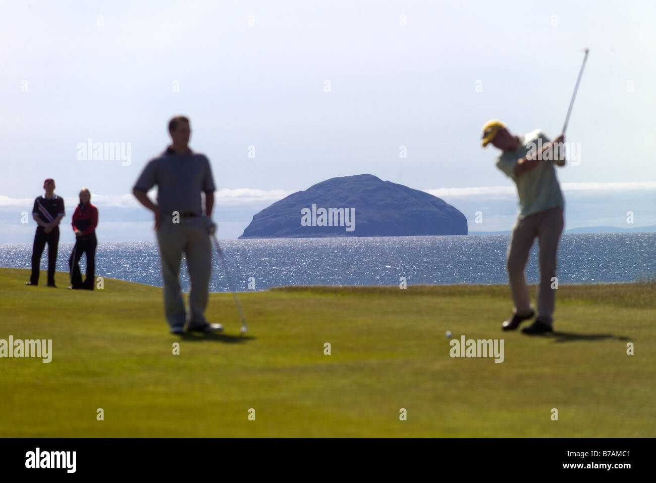 Ailsa Craig with golf tee off in foreground - Stock Image