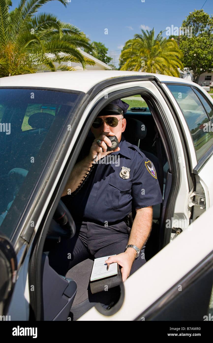 Police Officer Talking On Radio Stock Photos & Police