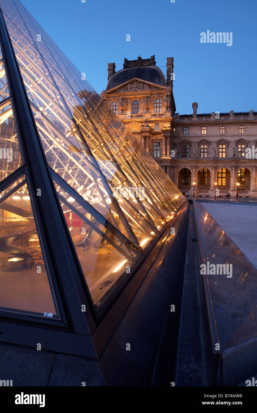 The Louvre Museum with glass pyramid Musée du Louvre at dusk Paris France Europe - Stock Image