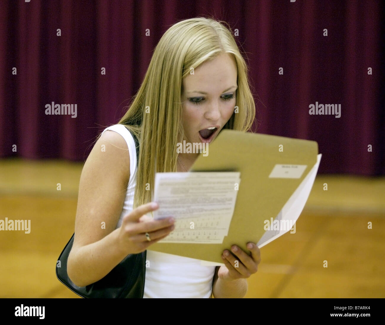 A girl reading her GCSE results at school in Shropshire can't hide her delight - Stock Image