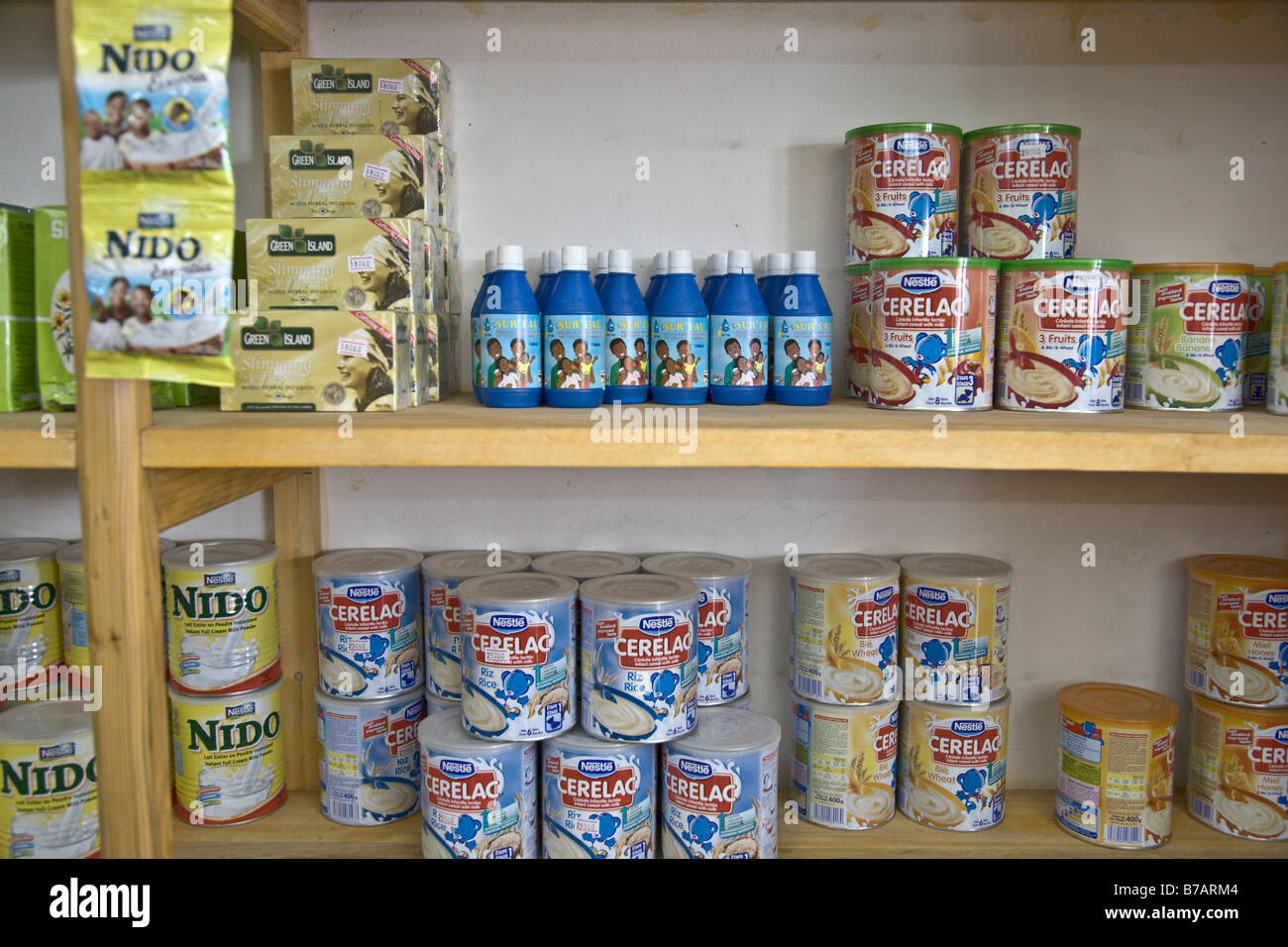 grocery store in Conakry, Guinea, sells bottles of Sur'Eau, a chlorine product that protects against diarrheal - Stock Image