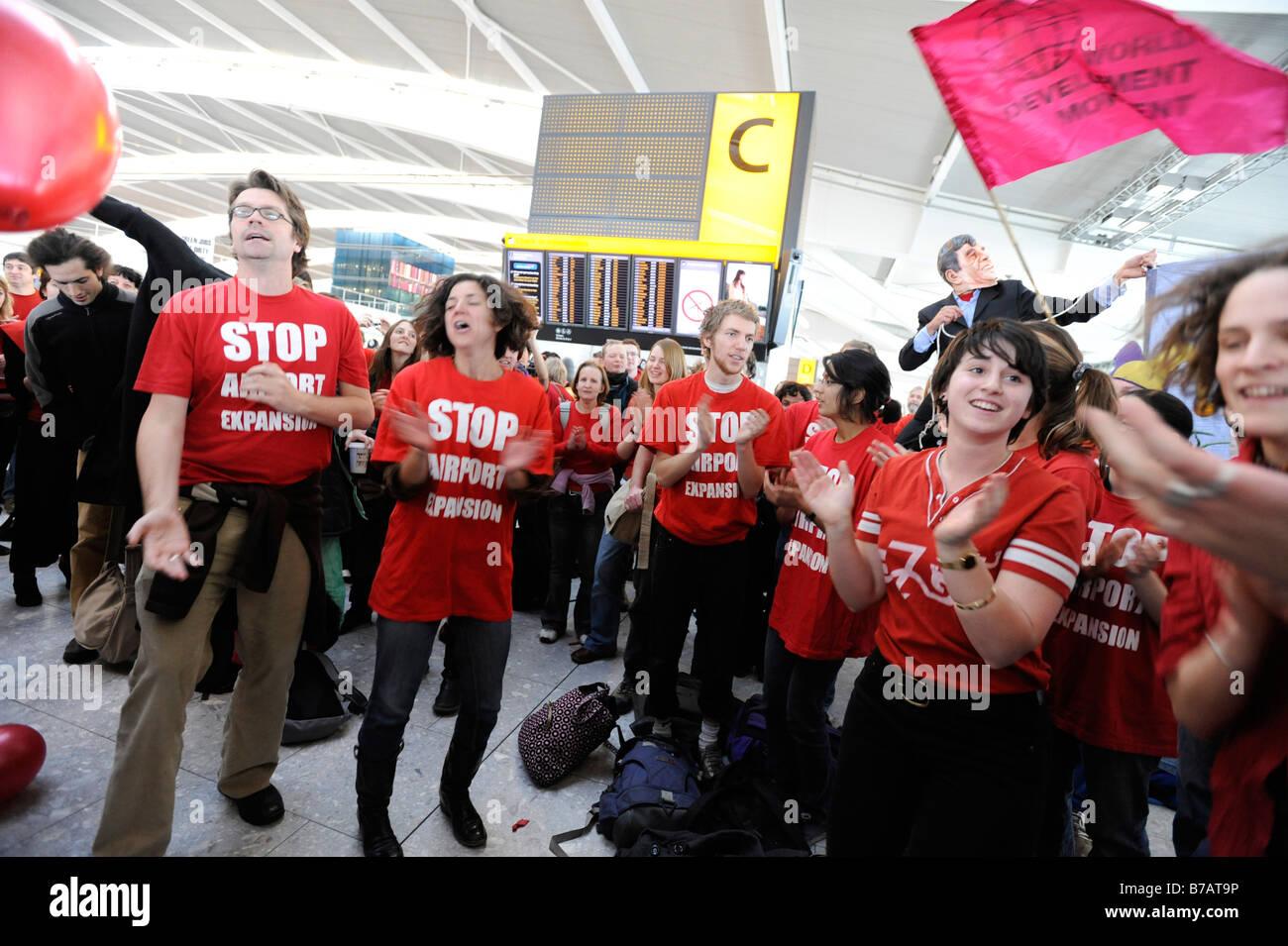 Flashmob No Third Runway protest at Heathrow airport Terminal 5 17 1 08 - Stock Image