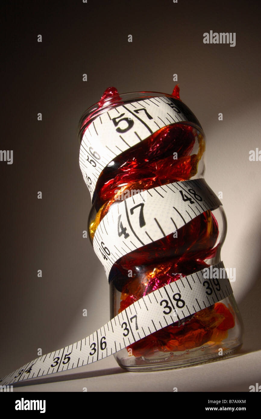 Measuring the bulge caused by sweets concept. - Stock Image