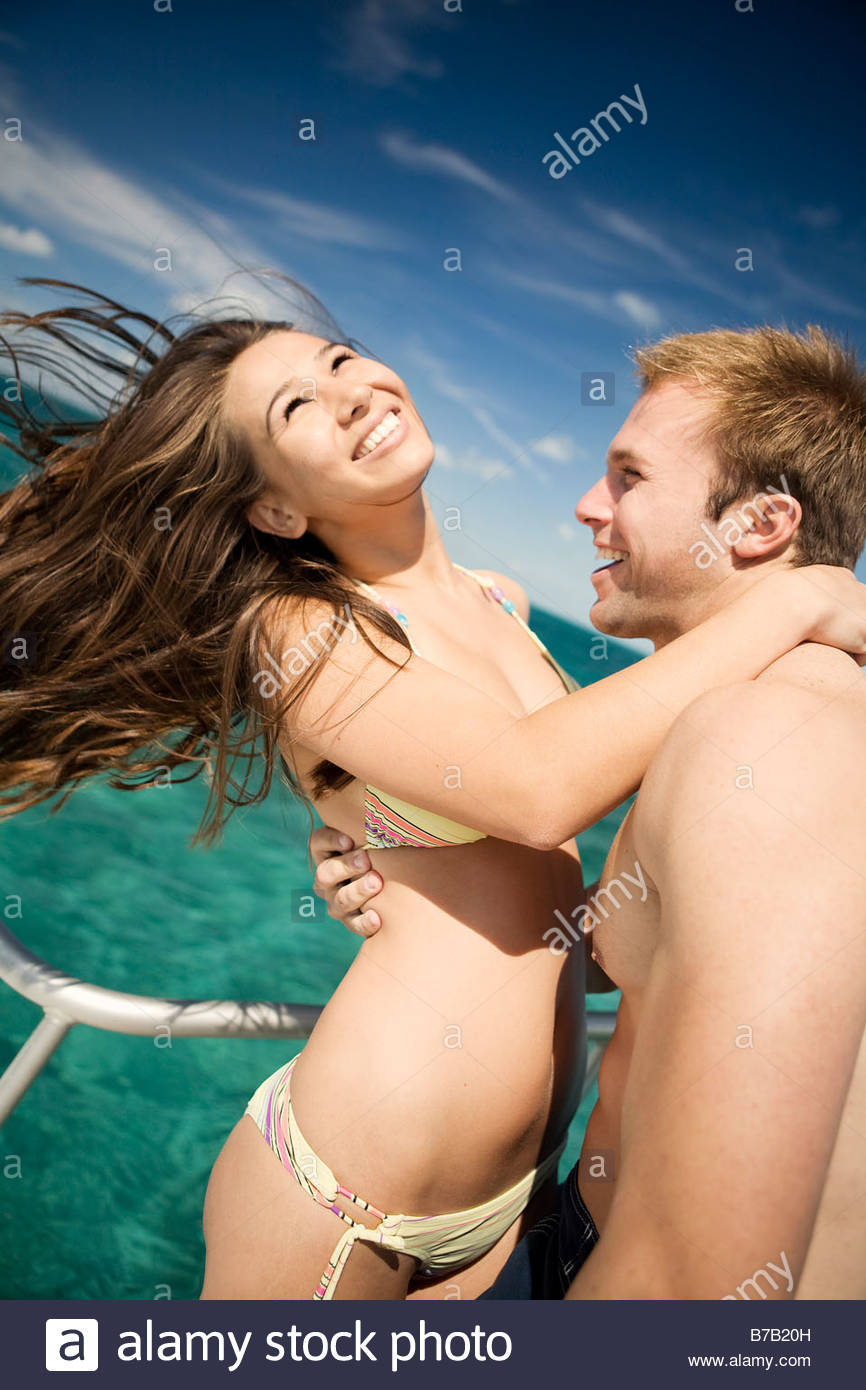 Couple hugging on boat - Stock Image