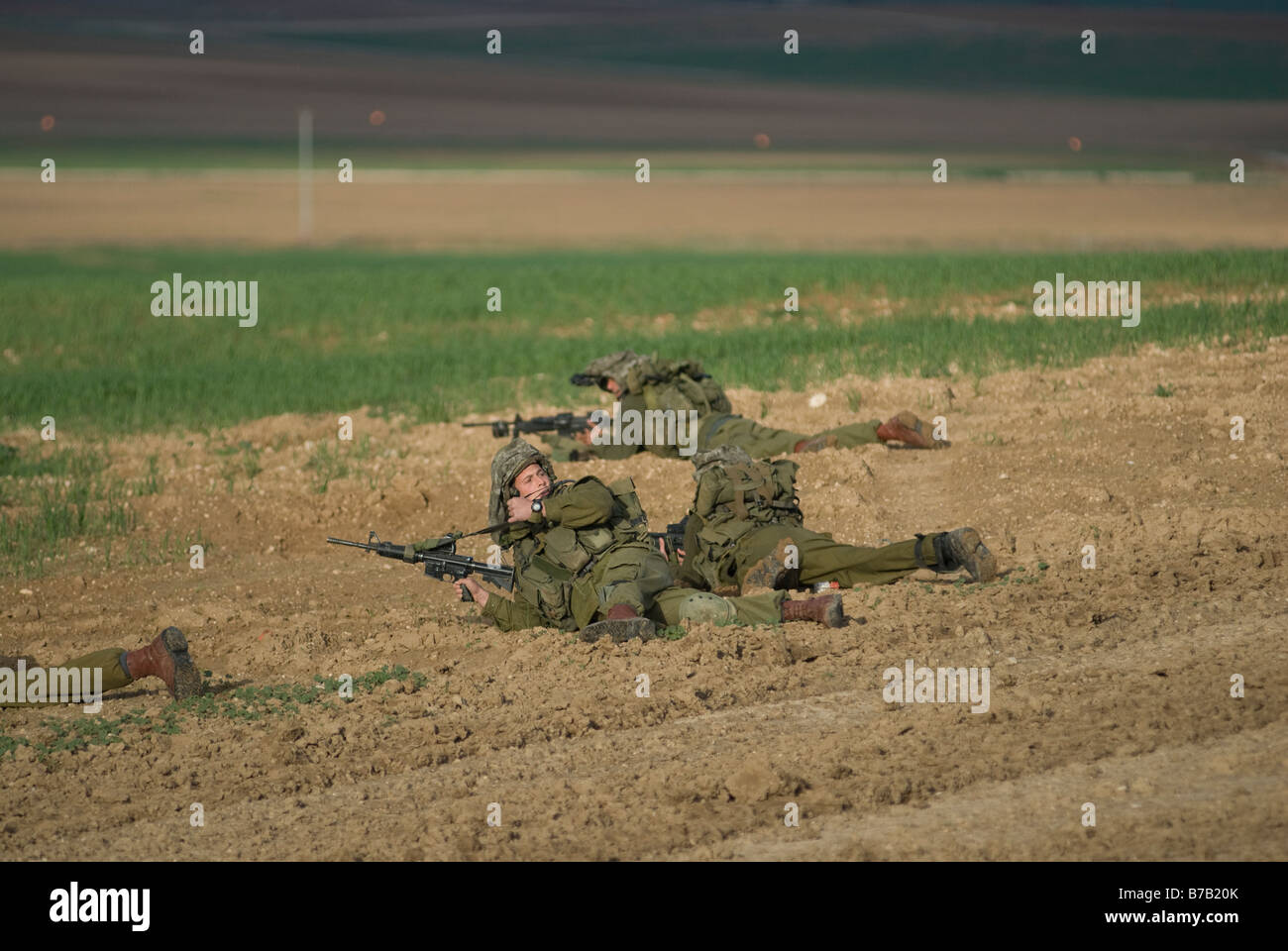 Elite Israeli soldiers taking battle position near the Gaza border, Israel. - Stock Image