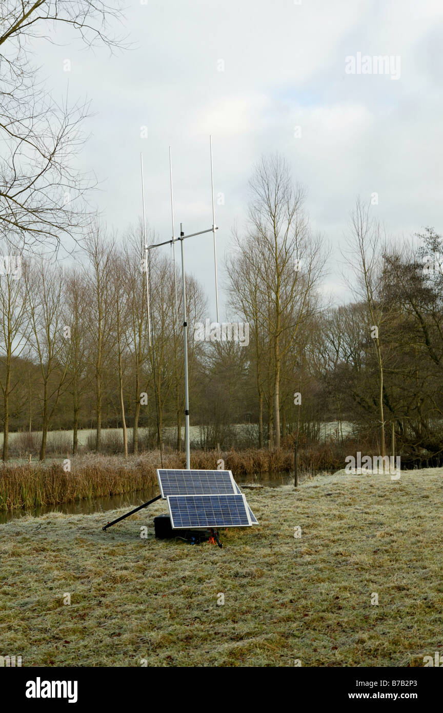 solar panel power in the rural essex countryside powering a communications Ariel - Stock Image