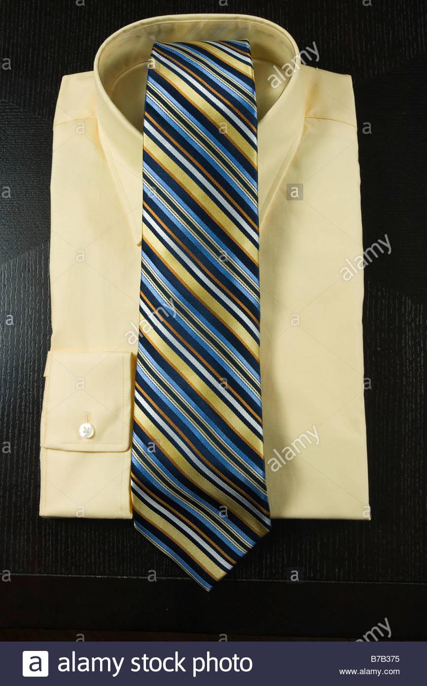 Yellow men's dress shirt with coordinating tie - Stock Image