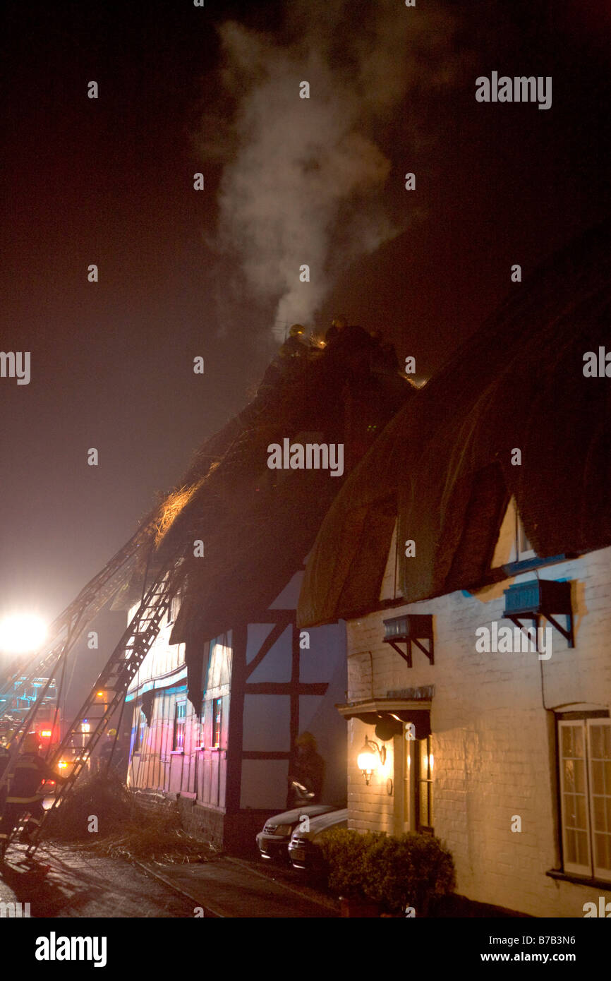 Fire in the Thatch Thached roof Upavon Wiltshire Attended by 14 Fire appliances and around 45 fire fighters - Stock Image