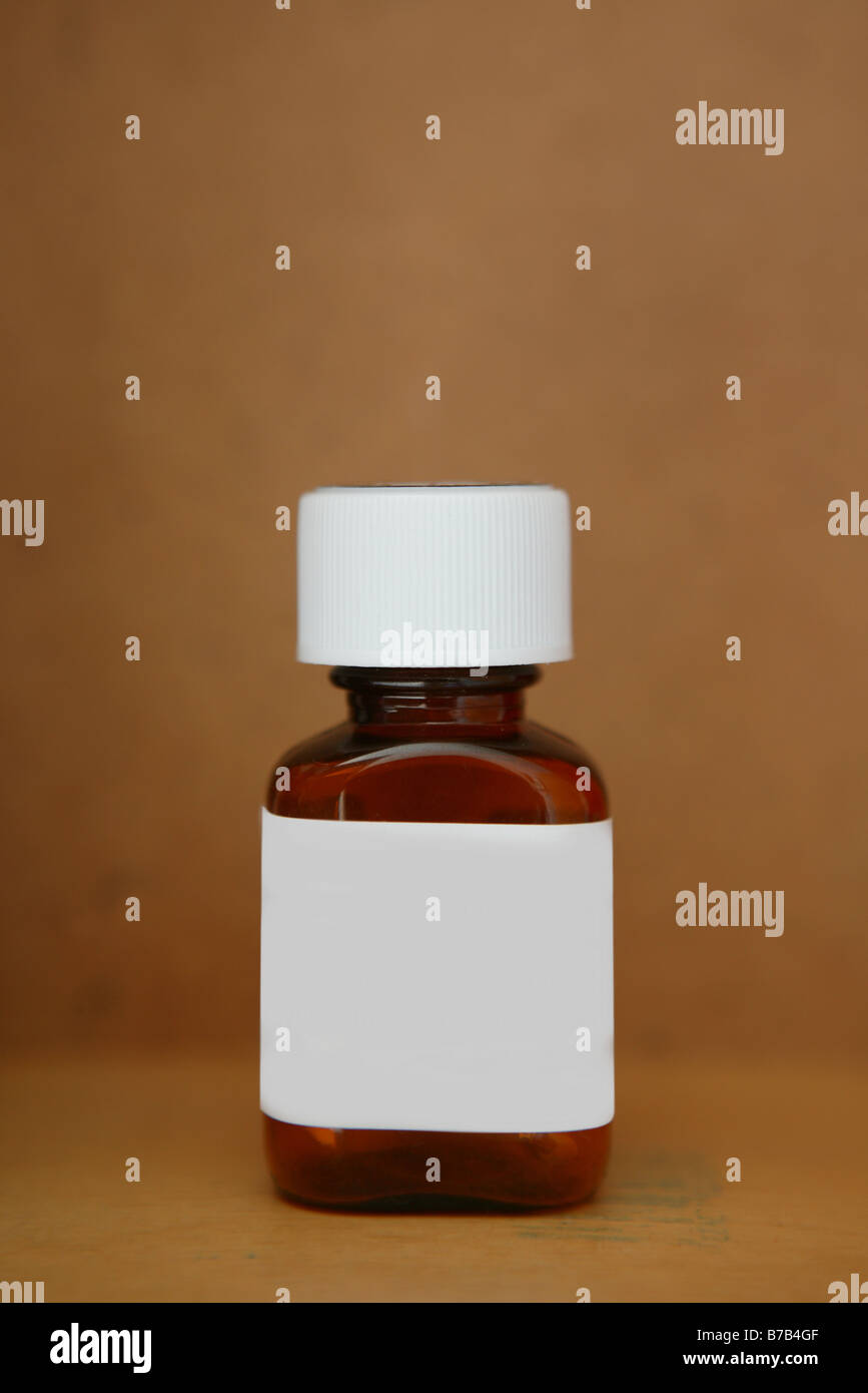 empty medical medication pill bottle tub with a blank white label on ...