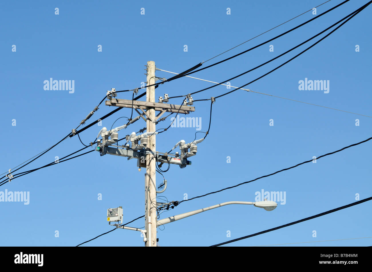 Telephone and electric pole with wires insulators cables and street ...