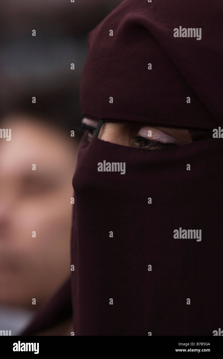 Islamic woman wearing the yashmak - Stock Image