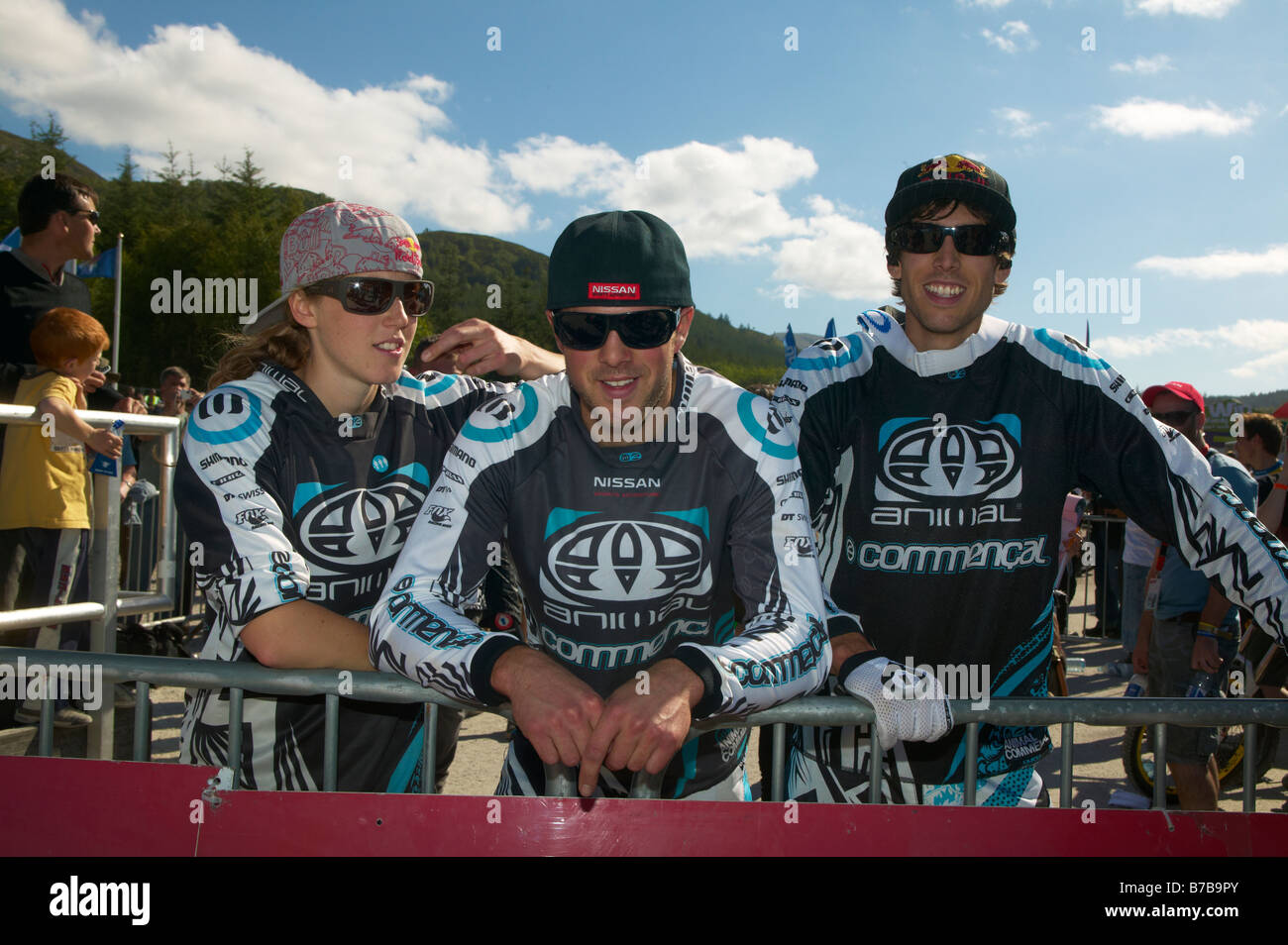 Rachel Dan and Gee Atherton team Animal Commencal downhill mountain bikers at Fort William Scotland World Cup event - Stock Image