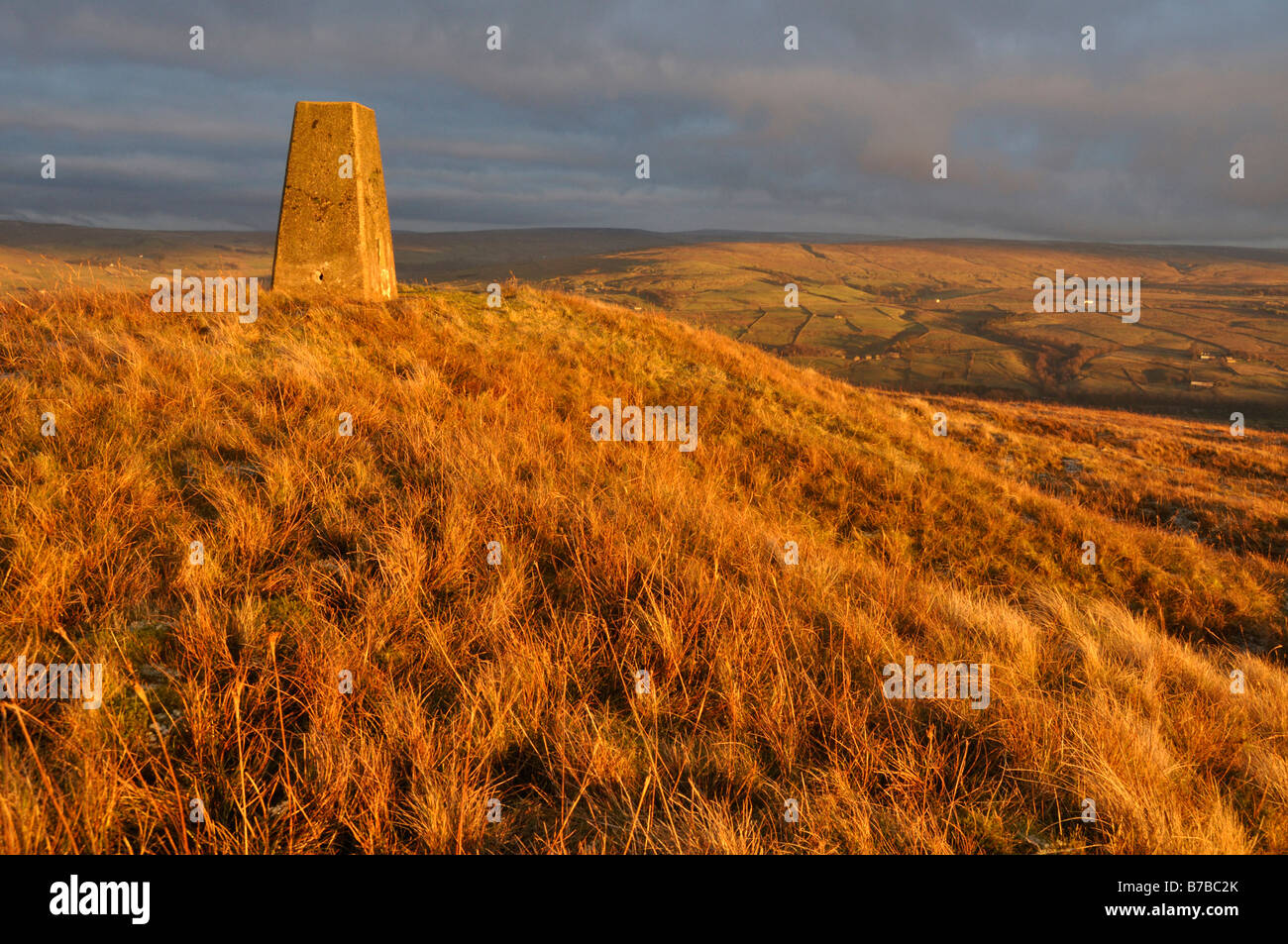 Evening light on trig point Park fell North Pennines, England - Stock Image