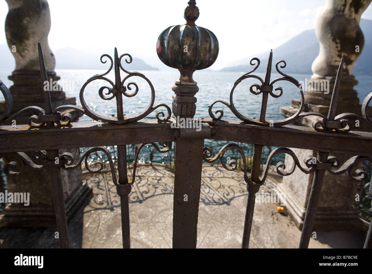 Hand-made old aristocratic waterfront gate. Varenna, Villa Monastero, Lecco, Lake Como, Italy - Stock Image