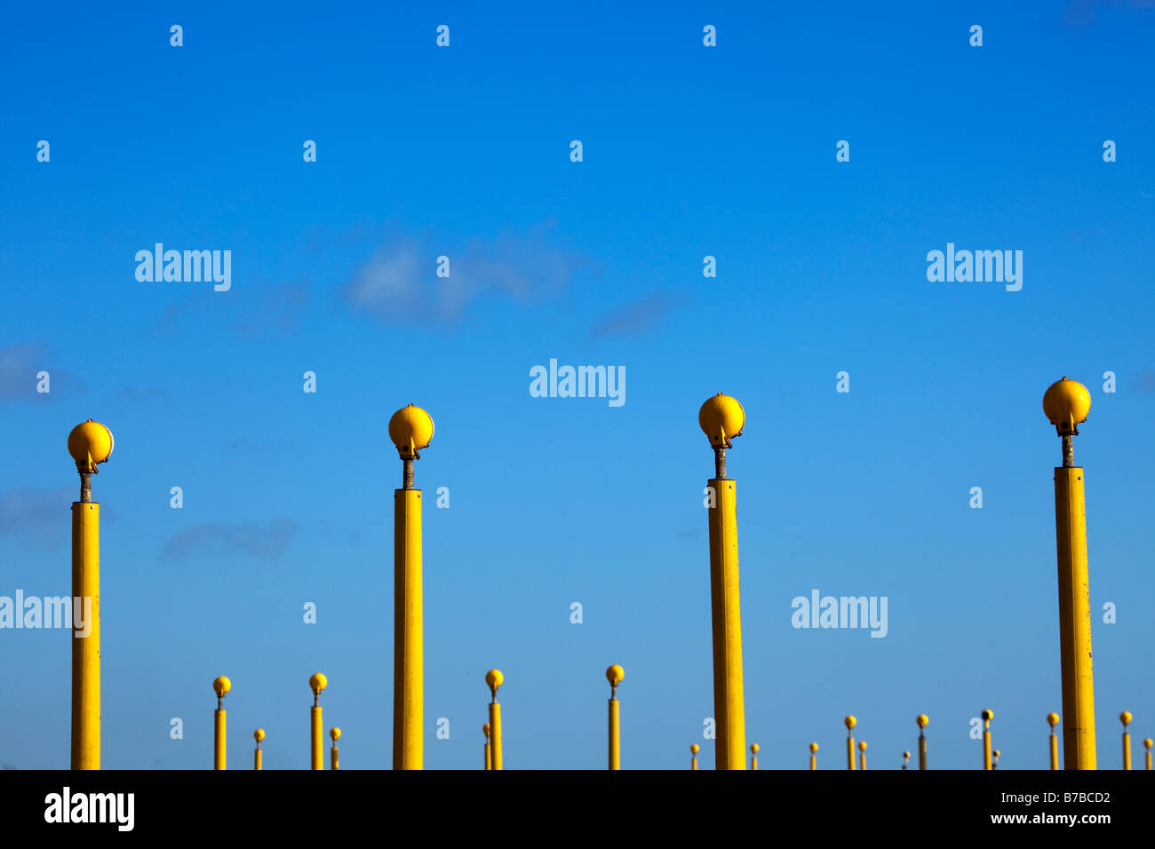Bright yellow runway lights against a blue cloudless sky at the arrival runway at John Lenon Airport, Liverpool, - Stock Image