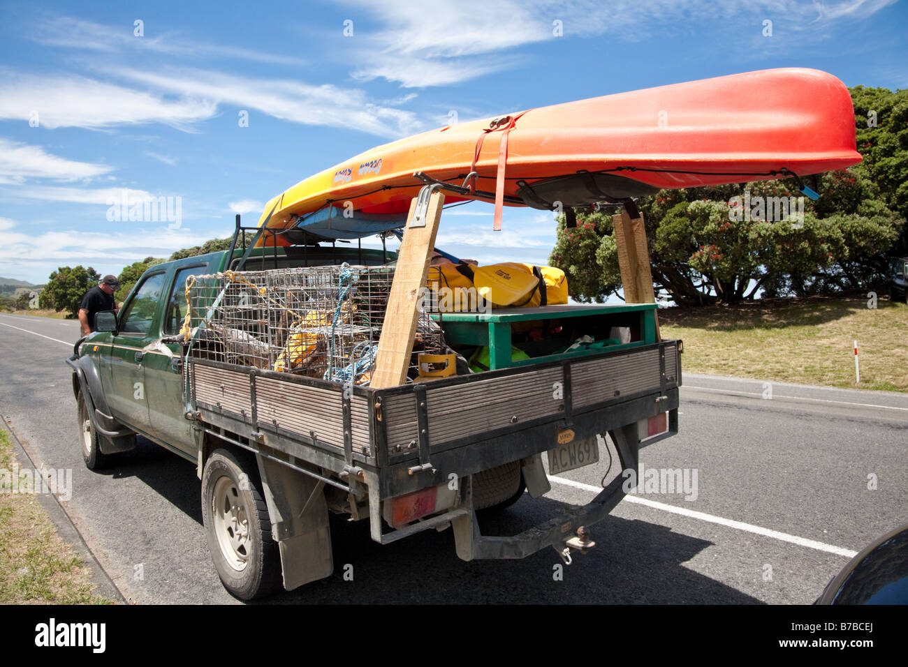 Pickup Truck Ute Loaded For The Holidays With Lobster Traps And Kayak Stock