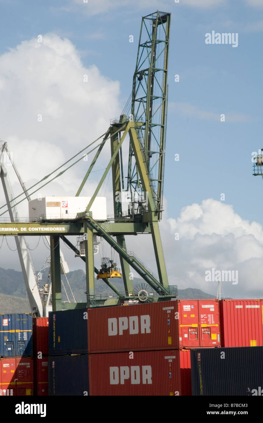 shipping containers container containerized docks import export imported exported goods crane lifting gear equipment - Stock Image