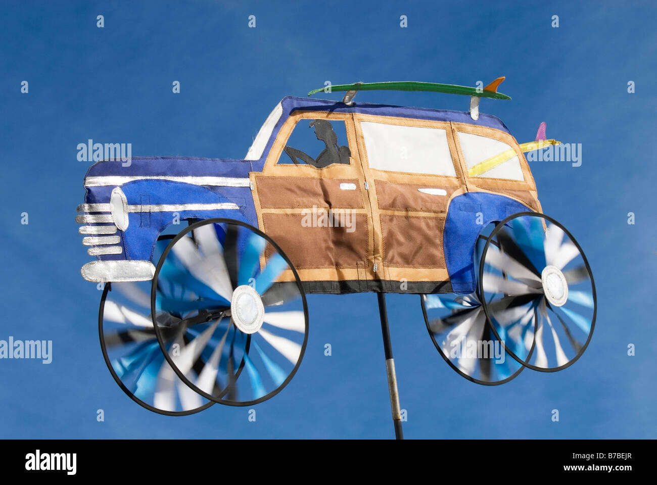 A display of an auto being suspended in the air while the wind moves it Photo taken 14DEC08 in Venice California - Stock Image