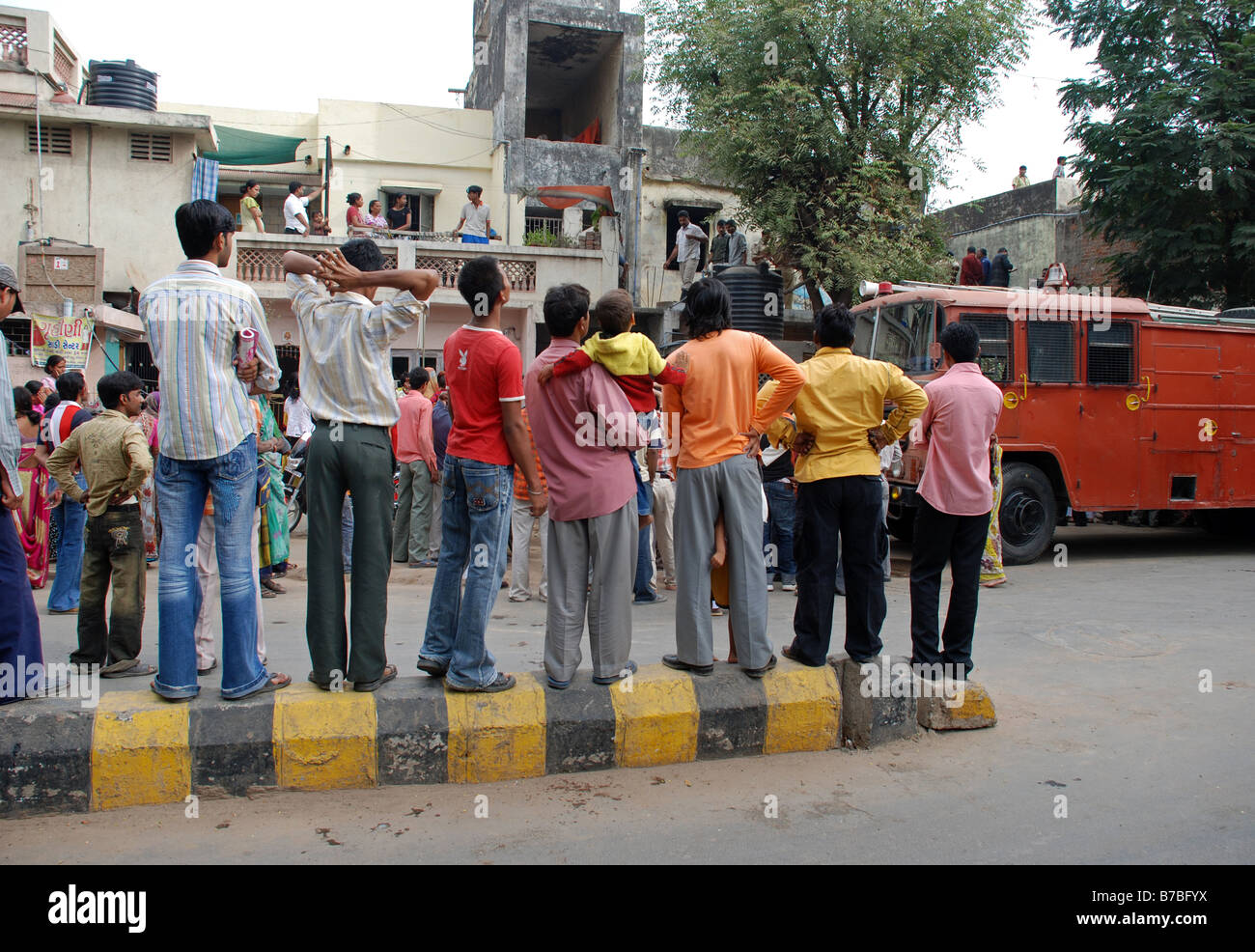 People watching a fire scene in Ahmedabad, India. - Stock Image