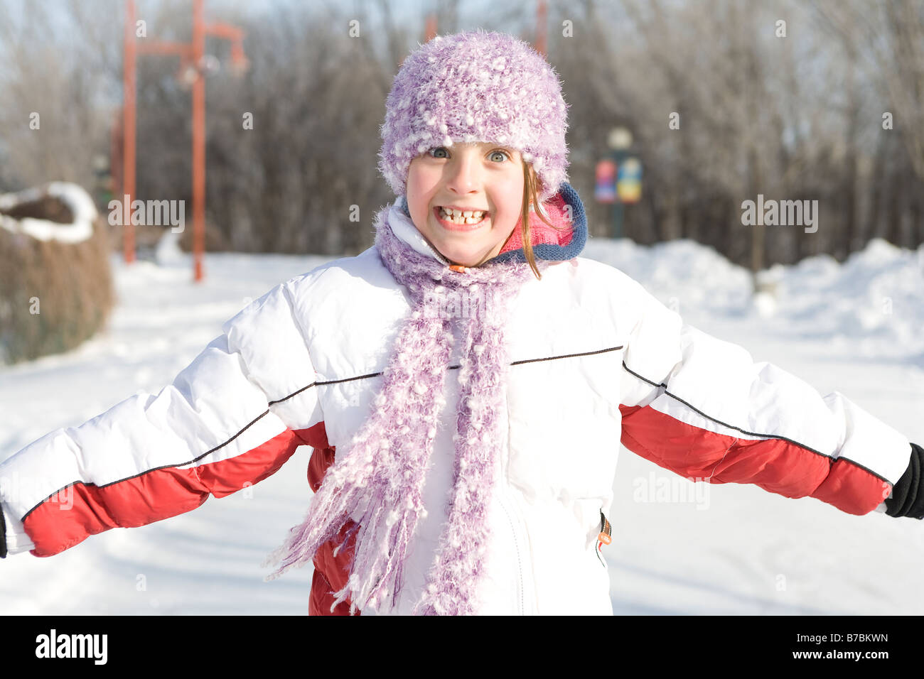 9 year old girl pulls a face, outdoor winter, The Forks, Winnipeg, Canada - Stock Image