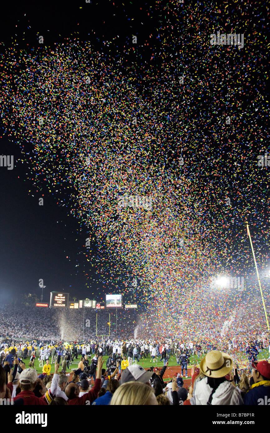 Colorful confetti falls on the crowd at the annual New Years Day Rose Bowl football game - Stock Image