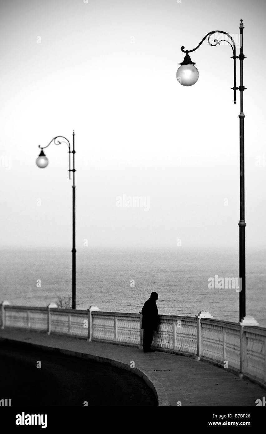 Italy. Man contemplating the sea - Stock Image