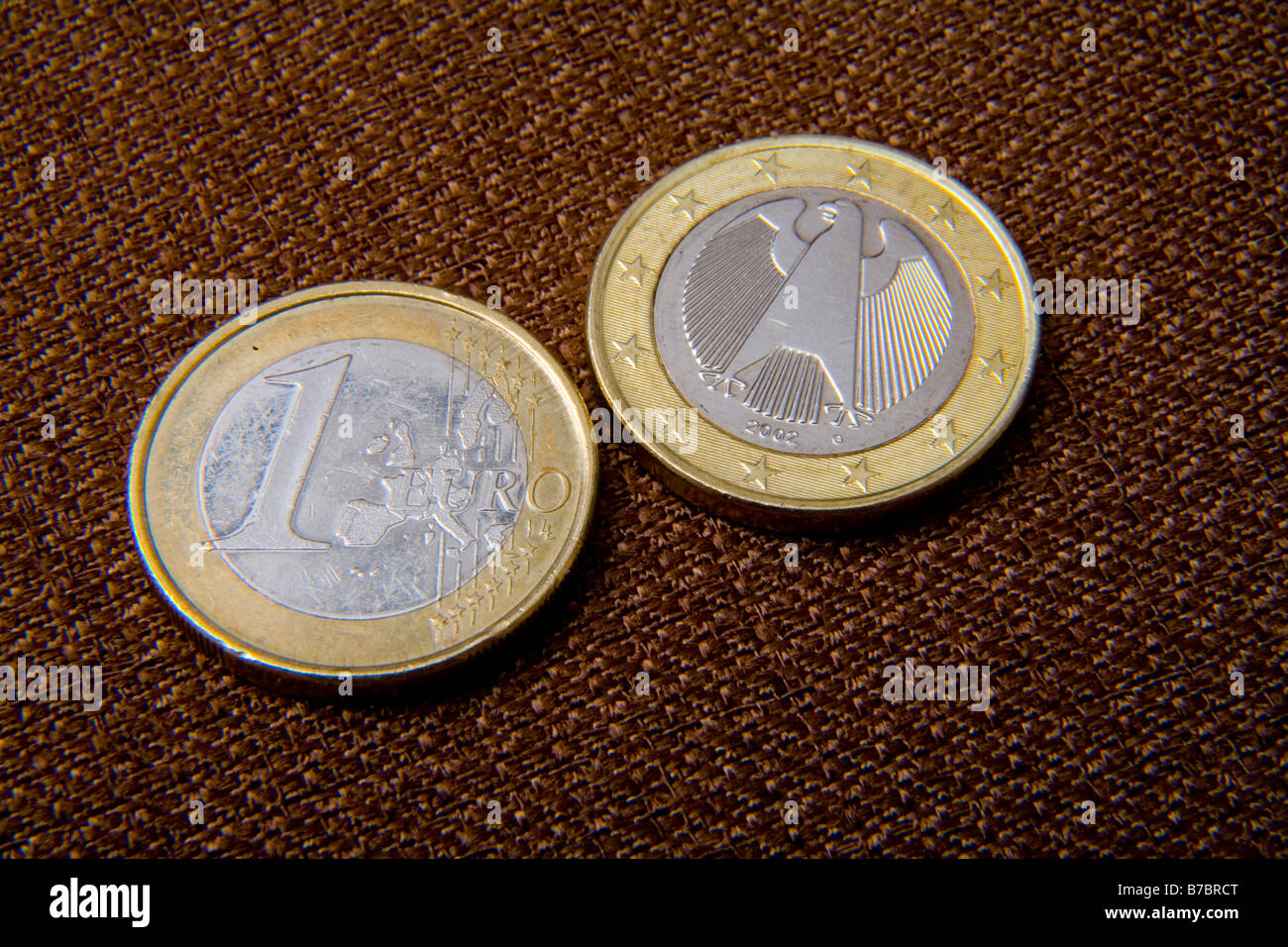 Front and reverse of 1 Euro coin from Germany Reverse image is different in each European Union nation  economy - Stock Image