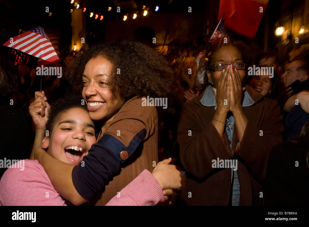 Elated US expatriate citizens celebrate Barack Obama's inauguration as the 44th US President in London. - Stock Image