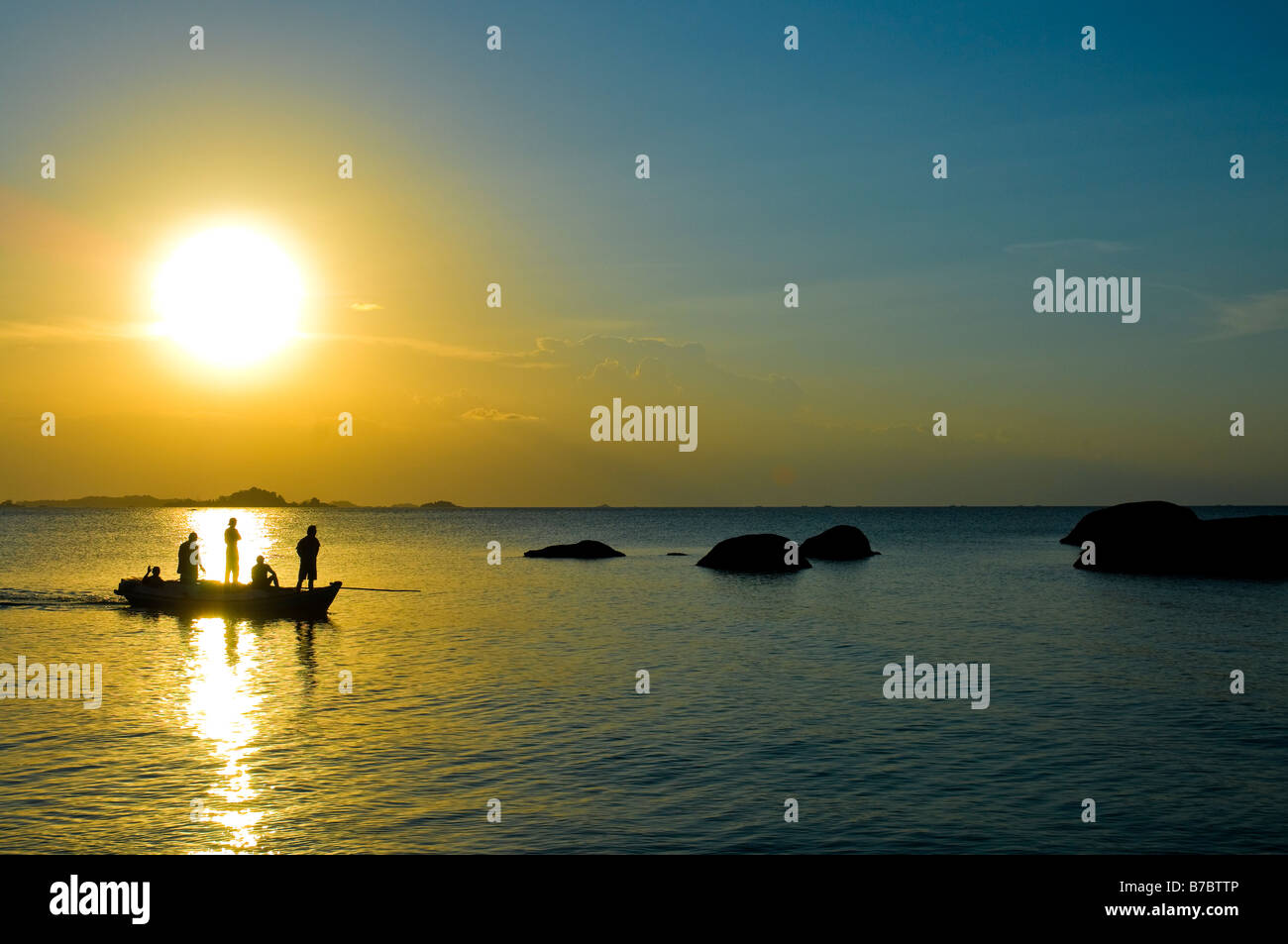 Local fisherman with the traditional fishing boat  at sunrise in Tanjung Tinggi, Belitung Stock Photo