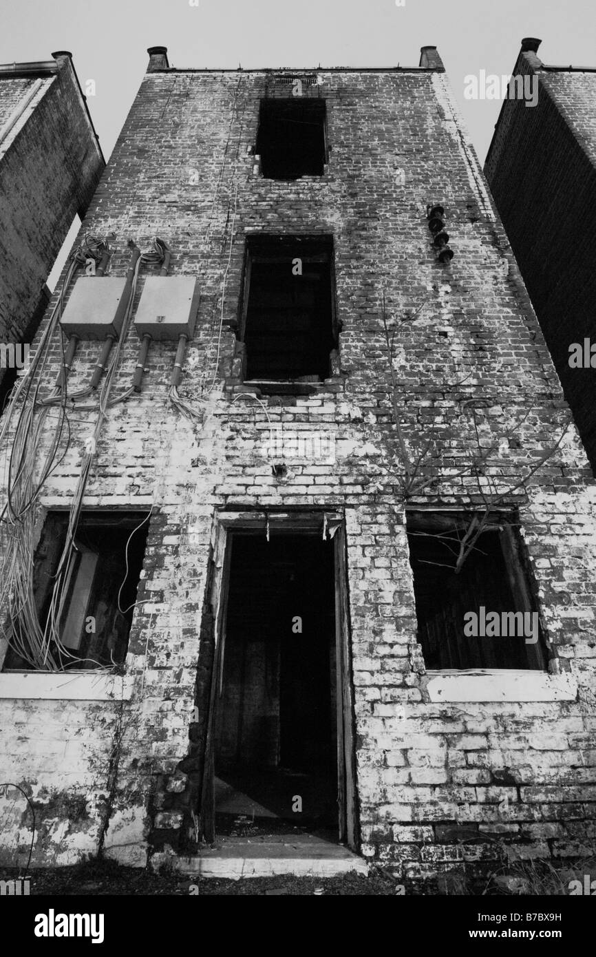 An old creepy and decrepit apartment/house. - Stock Image