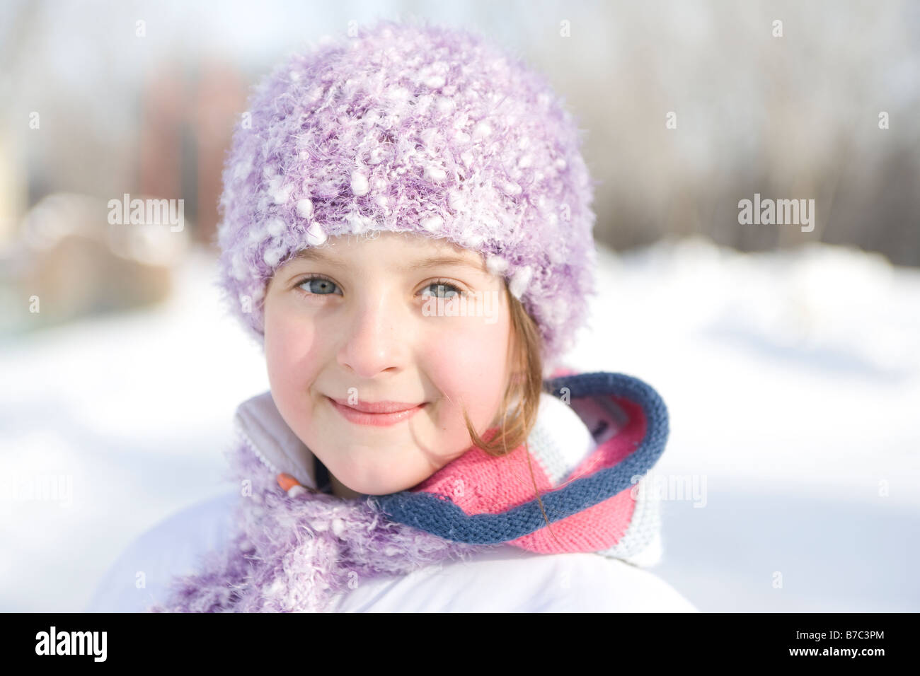 Portrait of 9 year-old girl outdoor in winter, Winnipeg, Canada - Stock Image