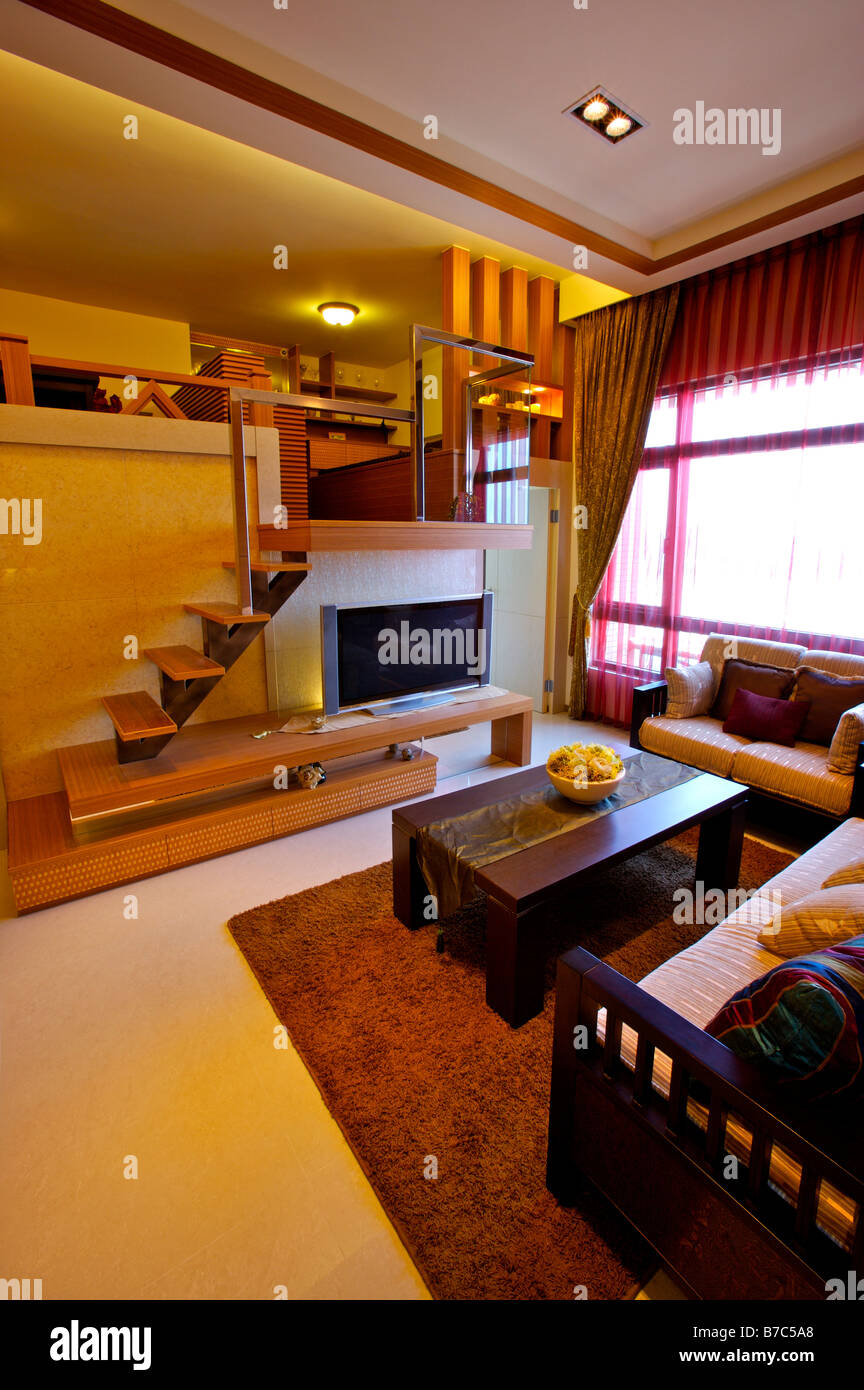 Modern Living Room With A Television And Stairs Leading To Another Stock Photo Alamy